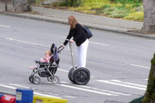 Funny Pictures of Walking Baby With Segway