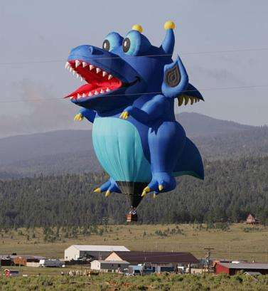 Funny Pictures of Dragon Baloon Over Farm