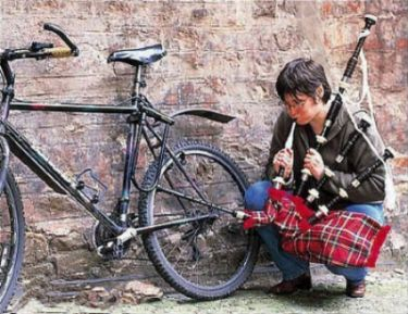 Funny Pictures of Bike Tire Being Pumped By Bagpipes