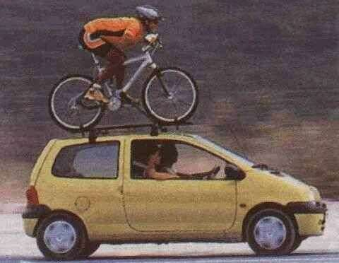 Funny Pictures of Bike and Rider on Roof of Car