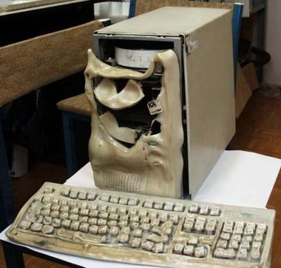 Funny Pictures of Melted, Overclocked Computer