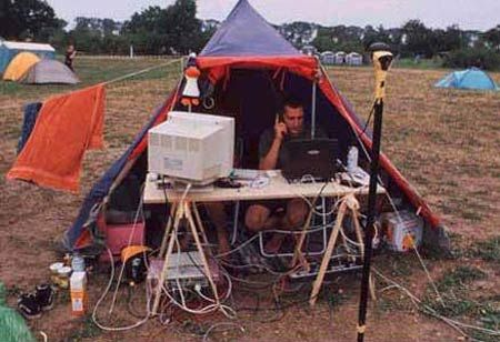 Funny Pictures of Of Man In Tent With Computer