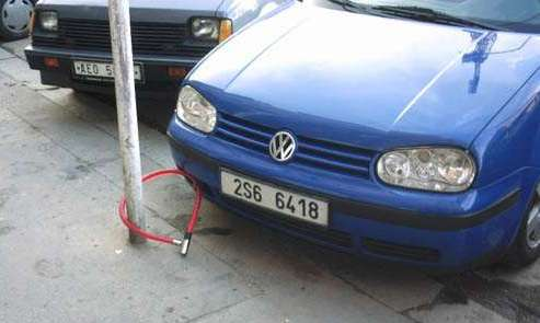 Funny Pictures of Car Padlocked to Pole