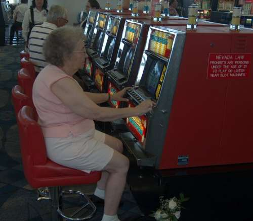 Funny Pictures of Grandma Playing Slot Machine in Las Vegas