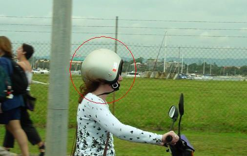 Funny Pictures of Motorcycle Helmet On Backwards