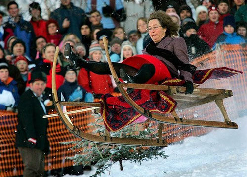 Funny Pictures of Mom On Winter Sleigh