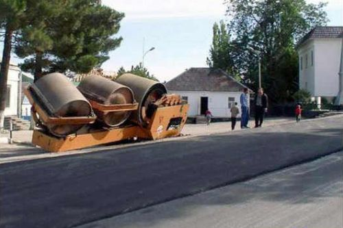 Funny Pictures of Pavement Rollar Flipped Over