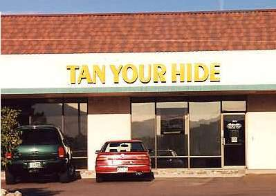 Funny Pictures of Tan Your Hide Sign