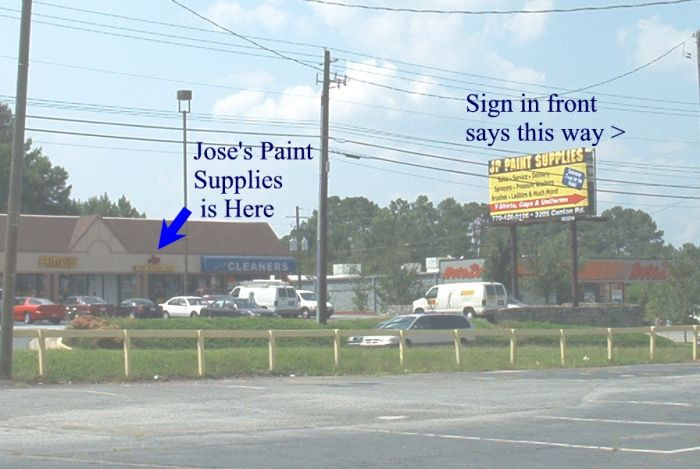 Funny Pictures of Paint Supply Sign Pointing Wrong Way