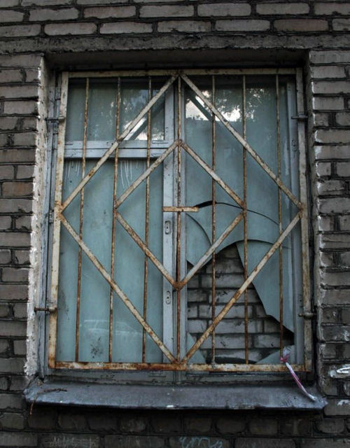 Funny Pictures of Barred and Bricked Window