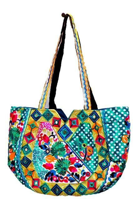 blue lady's embroidered hand bag