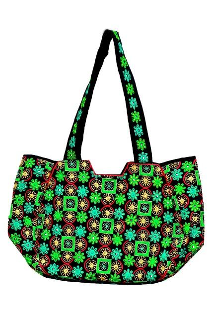 A green handbag made by a Pakistani Woman
