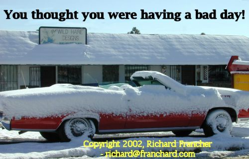Funny Pictures of a Topless Convertable Covered in Snow