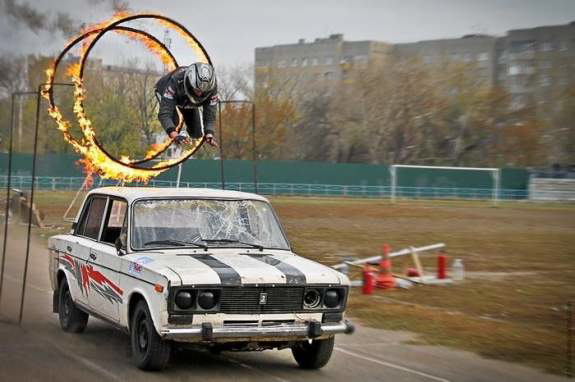 Jumping through a ring of fire on a car.
